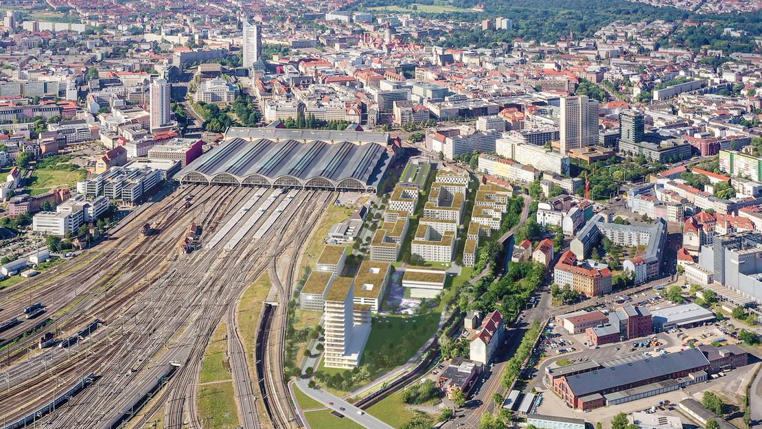 Luftbildaufnahme des Leipziger Hauptbahnhof von Norden gesehen mit Simulation eines benachbarten Neubauquartiers.